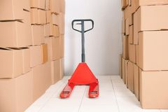 Manual pallet truck. With carton boxes stock images