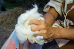 Manual processing of wool Stock Images