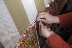 Manual production of carpets Royalty Free Stock Photography