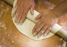 Manual rolling dough Royalty Free Stock Photography