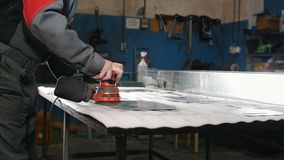Manual sander sanding a metal detail at the factory. Industrial concept stock video