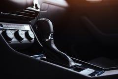 Manual shift of modern car gear shifter Stock Photos