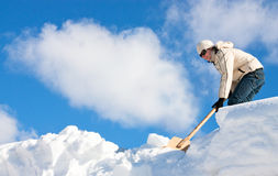 Manual snow removal royalty free stock photo
