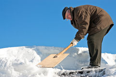 Manual snow removal Stock Image