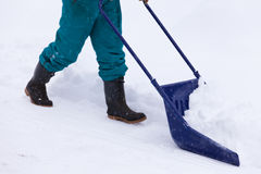 Manual snow removal with snow scoop after blizzard Stock Image