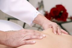 Manual therapy on the back. Work done by woman physiotherapist royalty free stock photo