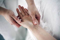 Manual therapy on the palms of the hands royalty free stock photography