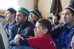 Manual to moslems. Moslems listening the sermon in throw mountain settlement Shulani (Dagestan. Russia Stock Photos