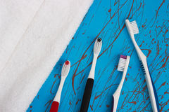 Manual toothbrush set isolated on blue background Royalty Free Stock Photo