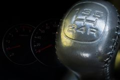 Manual transmission gear shift with speedmeter car dashboard Stock Image