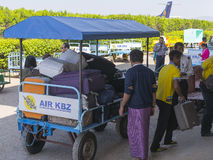 Manual transport of luggage of passengers. A small Nyaung U International Airport port in Bagan Myanmar (Burma stock photography