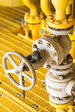 Manual valve in oil and gas industry, old valve and many rust present on the valve, Equipment for control production process Royalty Free Stock Images