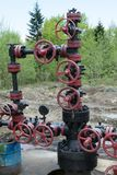 Manual valves on the pipes. Of the oil producing station in Carpathian Mountains, Ukraine. Think three times before turning any of them - the oil medium in the stock images