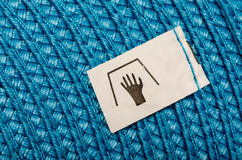 Manual Wash Label. On A Blue Cloth royalty free stock images