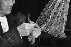 Manual weaving fishing net Stock Photos