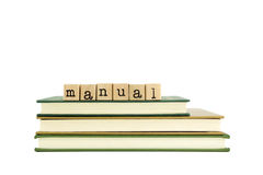 Manual word on wood stamps and books Royalty Free Stock Photo