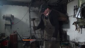Manual Work of Blacksmith in a Workshop