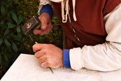 Manual work , craftsman , sculptor Stock Photo