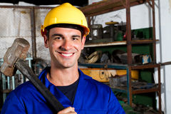 Manual worker. Happy male manual worker in factory stock photography