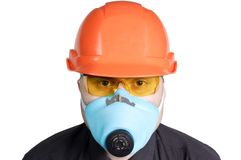 Manual worker. The builder in a building helmet and a gas mask on the isolated white background Royalty Free Stock Photos