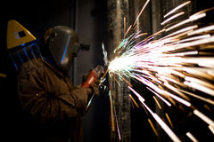 Manual worker. With metal cutting tool Stock Photography