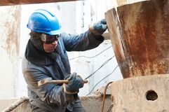 Manual worker in action with hammer Stock Photography