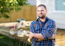 Manual Worker With Arms Crossed Standing At Royalty Free Stock Photography