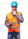 Manual worker in blue helmet with digital tablet Royalty Free Stock Photography