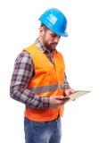 Manual worker in blue helmet Royalty Free Stock Image