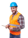 Manual worker in blue helmet using a digital tablet. Manual worker in blue helmet and shirt using a digital tablet,  on white Royalty Free Stock Photography