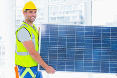 Manual worker carrying solar panel at office Stock Photography