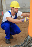 Manual worker checking power supply Stock Image