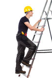 Manual worker climbing a ladder. Royalty Free Stock Photos