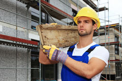 Manual worker on construction site Royalty Free Stock Photo