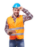 Manual worker with digital tablet. Manual worker in blue helmet with digital tablet, isolated on white Stock Images