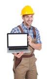 Manual worker displaying laptop Royalty Free Stock Image