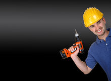 manual worker with  drill. Young caucasian manual worker with  drill background Stock Photos