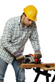 Manual worker and electric saw Stock Photography