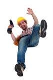 Manual worker falling. Stock Photos