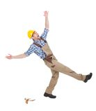 Manual worker falling over white background. Full length of young manual worker falling over white background royalty free stock image