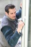 Manual worker fitting door Stock Photos