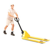 Manual worker and a fork pallet truck stacker Stock Photography