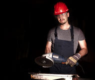 Manual worker with grinder royalty free stock photography