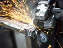 Manual worker grinding steel table Royalty Free Stock Image