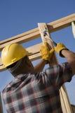 Manual Worker Hammering Nail At Site Royalty Free Stock Photo