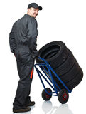 Manual worker with handtruck Stock Images