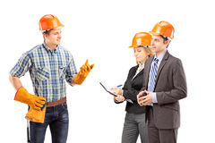 Manual worker having a conversation with architects Royalty Free Stock Photos