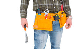 Manual worker holding hammer Royalty Free Stock Photos