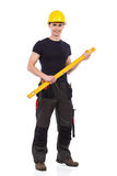 Manual worker holding a measuring instrument Royalty Free Stock Photos