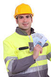 Manual worker holding money Royalty Free Stock Images